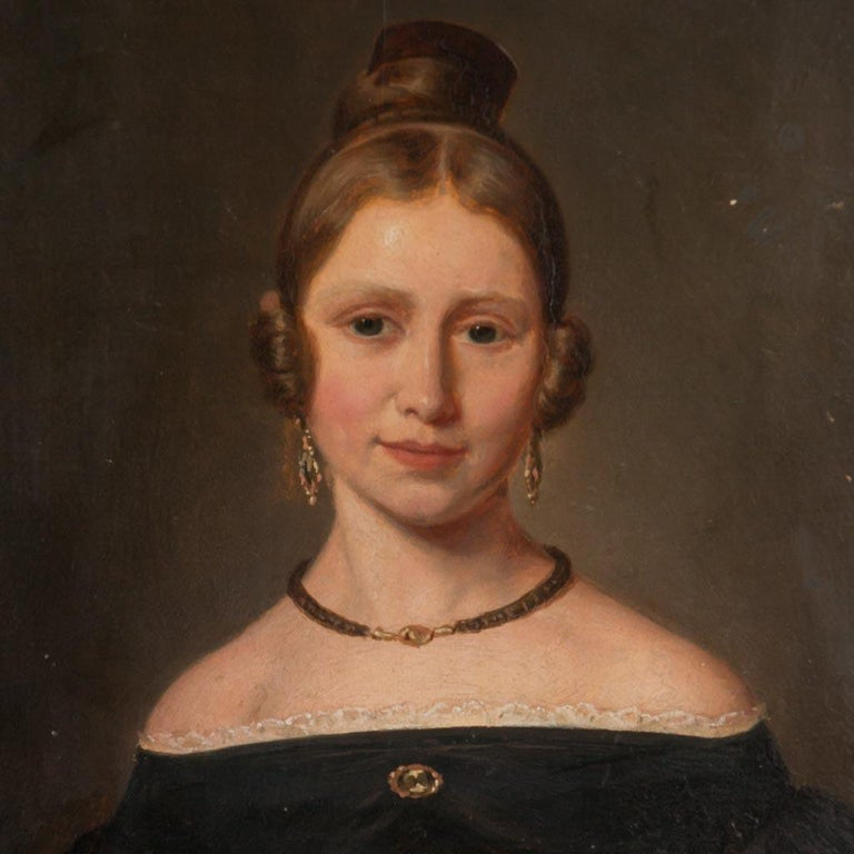 This lovely young woman is portrayed in great detail, from the lace trim on her period black satin dress to the lovely earrings and broach she wears. Note her youthful, rosy cheeks and the gentle gaze in her eyes. This sweet portrait contains an