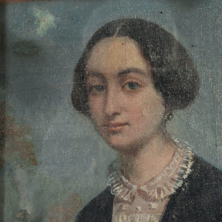 This well rendered and detailed antique Danish oil painting portrait portrays a lady in period outfit, dressed in black with a white lace collar, circa 1860-1880. There are quite a few repairs to the painting, visible on the front and canvas back