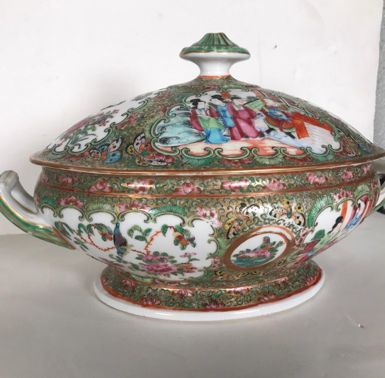Exceptional quality mid-19th century Chinese export porcelain tureen. Hand painted all-over with typical robed figures, peonies and butterflies with a gilded background. The double handled form rests on a pedestal base and retains most of the