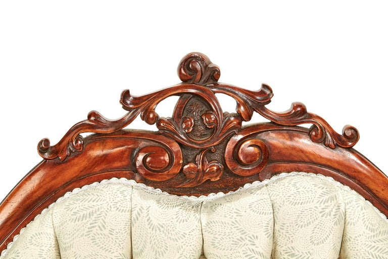 A magnificent antique 19th century Victorian walnut carved sofa having a stunning walnut show frame back with superior leaf carving decoration, walnut show frame front with delightful carved shaped front legs again with appealing carved leaf