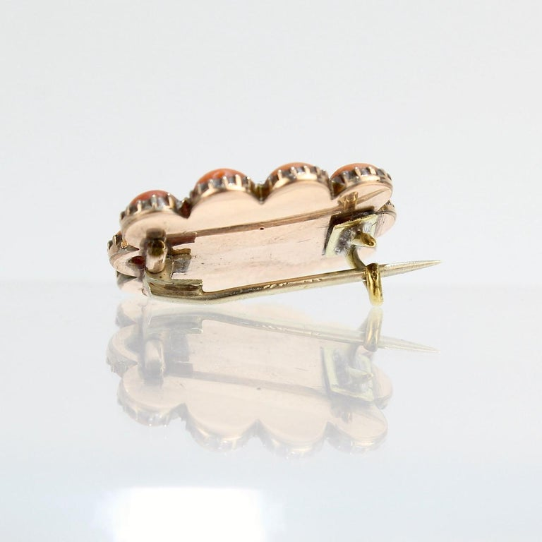 Women's or Men's Antique 19th Century Woven Hair Art Gold-Filled Brooch with Coral Cabochons For Sale