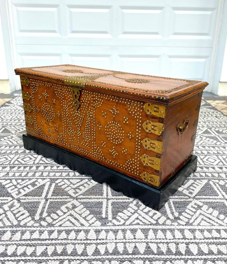 Hand-Carved Antique 19th Century Zanzibar Chest in Teak Wood with Brass Overlay and Studs For Sale