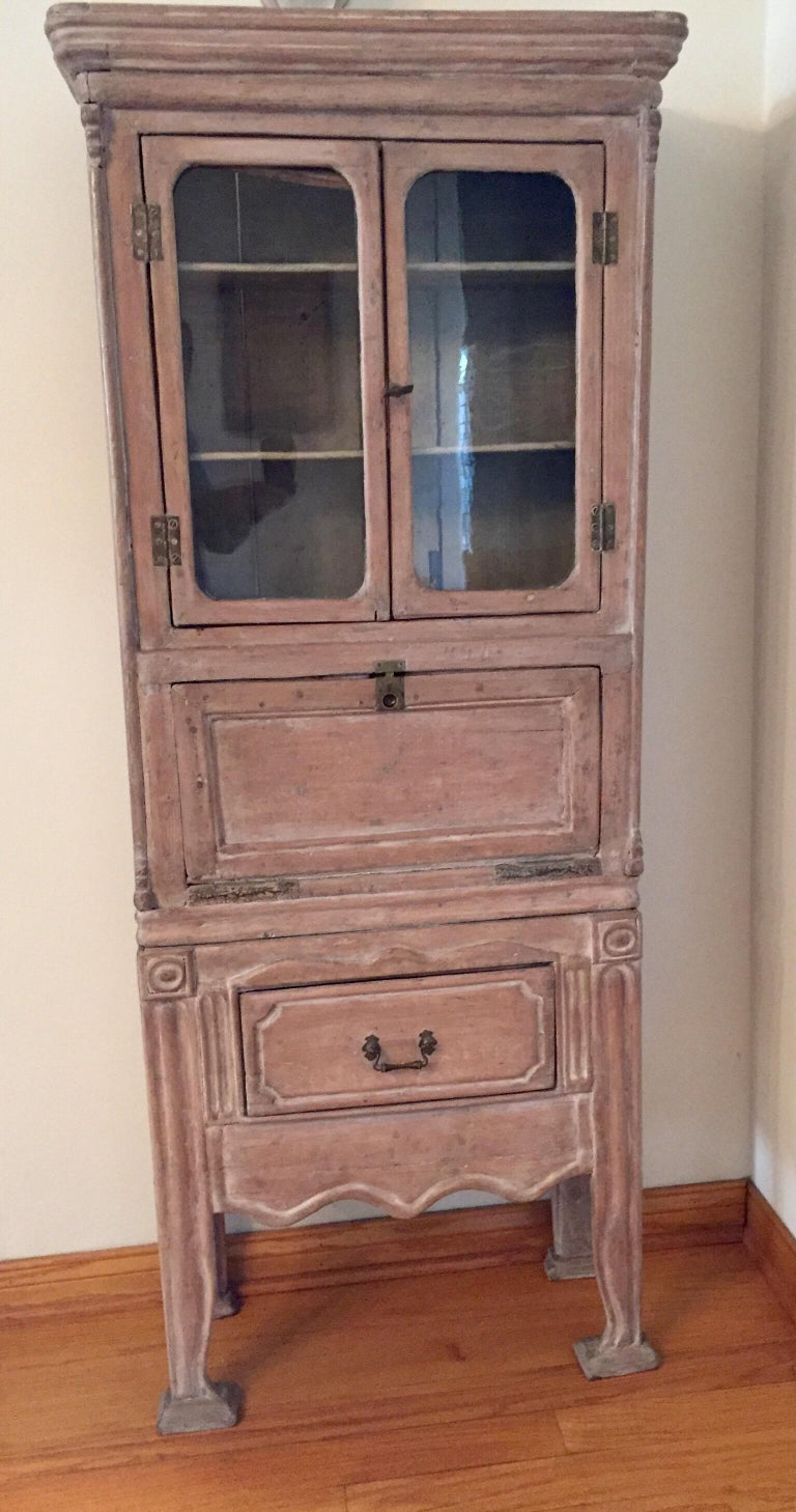 Antique late 19th century French petite Victorian cabinet secretary desk, circa 1900. Elegant with traces of old paint, good patina, pitch pine. An exquisite late 19th century French Provincial style writing desk with original brass hardware,