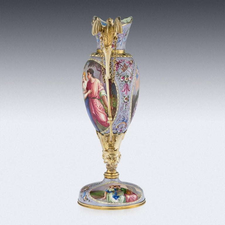 Antique late 19th century Austrian exceptional solid silver-gilt and enamel ewer, standing on a domed base, the hand painted enamel body supported with an acanthus leaf cornucopia and terminating with a satires head, resting a twist handle mounted