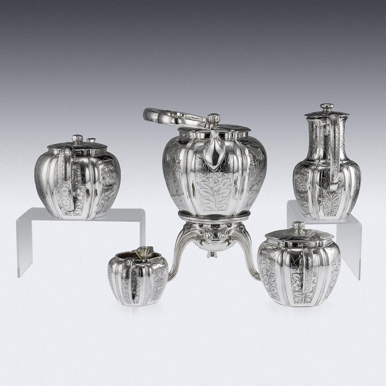Antique late 19th century French exceptional tea service, comprising: a silver plated hot water kettle, silver teapot, silver coffee pot, silver sugar bowl and silver cream jug, melon shaped with panels chased with chrysanthemums and scrolls on a