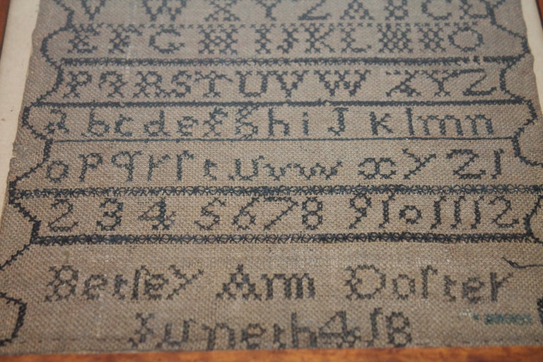 This fine school girl sampler was found in a collection in Philadelphia, Pennsylvania and is dated 1804 at the very bottom of the sampler. It was made by Beriey Ann Dorter ??? Hard to read.This was done on a handmade or woven homespun linen. It
