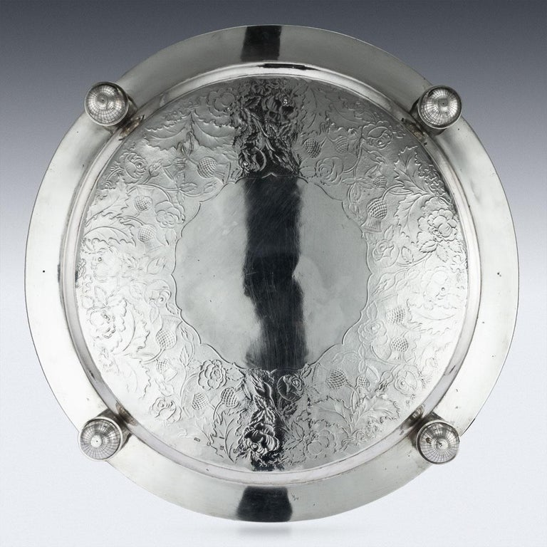 Antique 19th century Scottish solid silver salver with cast border, large size and extremely heavy gauge, of circular form with applied cast fruit and grapevine border, the tray is beautifully engraved with scrolling foliage and thistles on matted