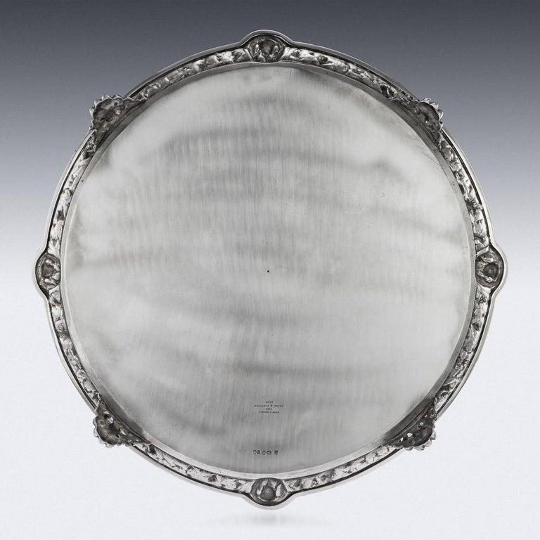 Antique 19th century Victorian solid silver salver with an unusual neoclassical border, impressively large size and extremely heavy gauge, of shaped-circular form on four impressive cast scroll feet, with applied cast border decorated with Italian