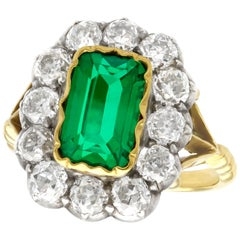 Antique 2 Carat Colombian Emerald & 2.2 Carat Diamond Yellow Gold Cocktail Ring