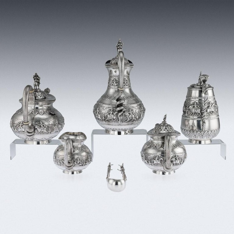 Antique early-20th Century Exceptional Indian colonial solid silver six-piece tea service, comprising of coffee pot, water jug, teapot, sugar bowl, cream jug, sugar tongs and a tray, each body is profusely and beautifully repousse' decorated with