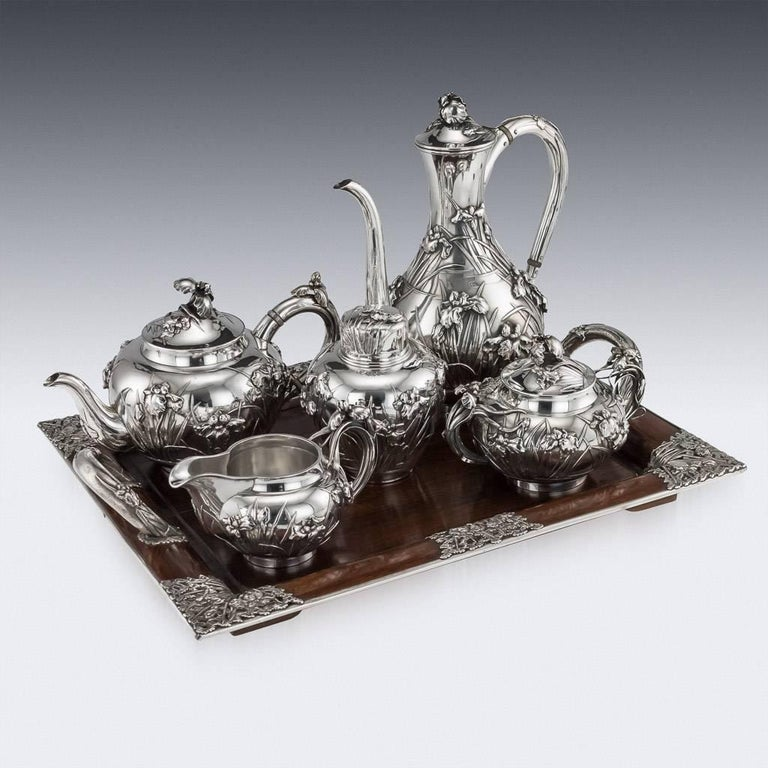 Antique early 20th century Japanese solid silver large five-piece tea and coffee service on silver mounted wooden tray, exceptional and magnificent quality, double walled, embossed and applied with Iris flowers in high relief, with C-form handles
