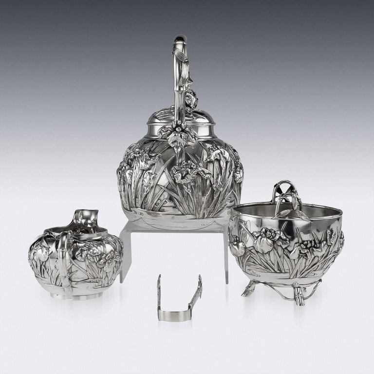 Description Antique early-20th century Japanese solid silver four piece tea set, exceptional quality, double walled, embossed with Iris flowers in water in high relief and body applies with bamboo leaves, C-form handles and lids applied with
