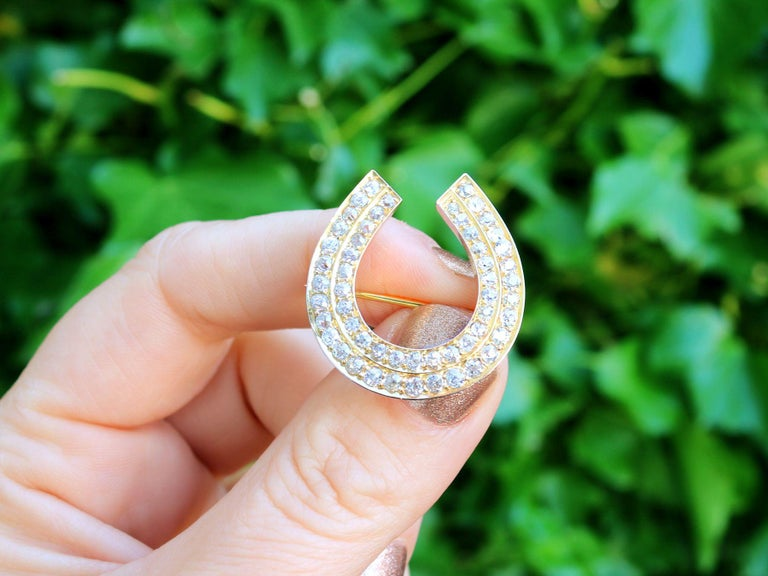A stunning, fine and impressive antique 2.36 carat diamond and 9 karat yellow gold horseshoe brooch; part of our diverse antique jewellery and estate jewelry collections.  This exceptional, fine and impressive antique brooch has been crafted in 9k