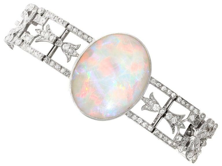 Cabochon Antique 24.66Ct Oval Cut Opal and 9.81Ct Diamond Platinum Bracelet For Sale