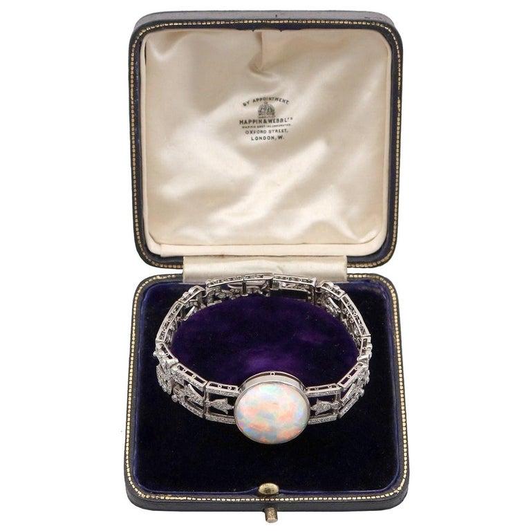 Antique 24.66Ct Oval Cut Opal and 9.81Ct Diamond Platinum Bracelet For Sale