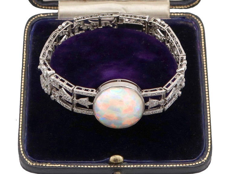 A stunning, fine and impressive antique 24.66 carat opal and 9.81 carat diamond, platinum bracelet; part of our diverse antique jewelry and estate jewelry collections  This stunning, fine and impressive antique bracelet has been crafted in