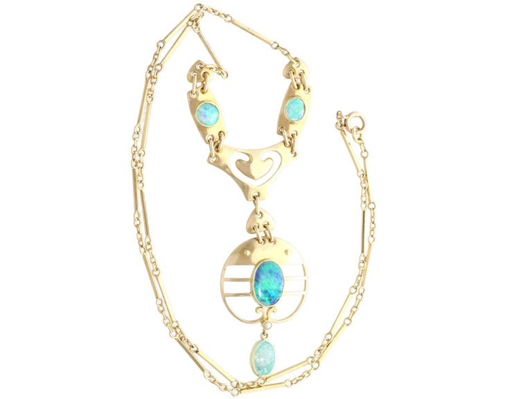 A fine and impressive antique Art Nouveau 2.62 carat opal and 15 karat yellow gold necklace made by Murrle Bennet & Co; part of our diverse antique jewelry and estate jewelry collections  This fine and impressive antique necklace has been crafted in