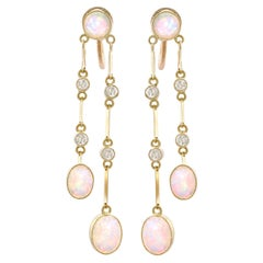 Antique 2.71 Carat Opal and Diamond, 15 Karat Yellow Gold Drop Earrings