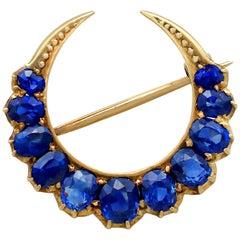Antique 2.91 Carat Sapphire Yellow Gold Crescent Brooch