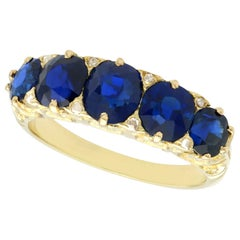 Antique 3.15 Carat Basaltic Sapphire and Diamond Yellow Gold Five-Stone Ring