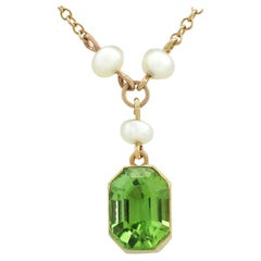 Antique 3.16 Carat Peridot and Seed Pearl Yellow Gold Pendant