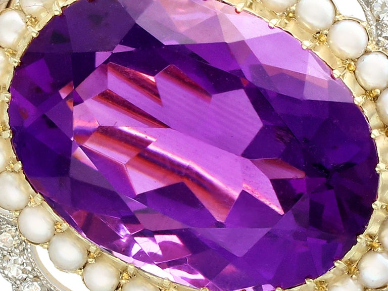 A stunning antique 34.49 carat amethyst and 2.95 carat diamond 15 karat yellow gold and platinum set brooch; part of our diverse antique jewellery and estate jewelry collections.  This stunning, fine and impressive antique brooch has been crafted in