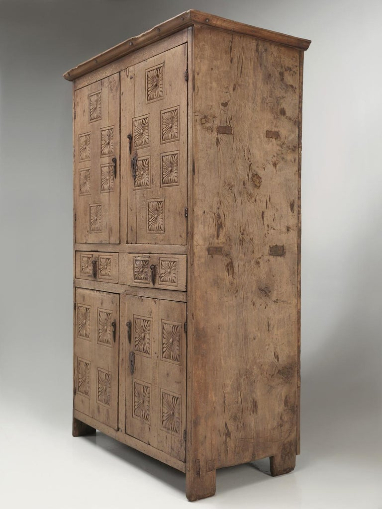 Generally, as soon as we unpack our container shipments from France, we pretty much know what we have, its age and country of origin. This antique cupboard or antique armoire has us a bit mystified as to its birthplace. Deciding how old was not