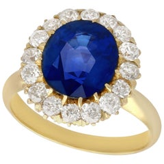 Antique 4.50 Carat Sapphire 1.46 Carat Diamond Yellow Gold Cluster Ring/Brooch
