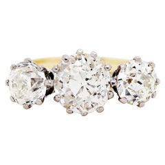 Antique 4.61 Carat Old Cut Diamond Three-Stone 18 Carat Gold Engagement Ring