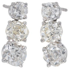 Antique 4.68 Carat Triple Old Mine Cushion Cut Diamond Platinum Dangle Earrings