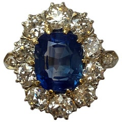 Antique 4.7 Carat SSEF Kashmir Sapphire and Diamond Cluster Ring