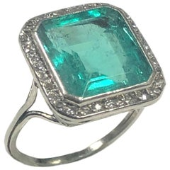 Antique 5 Carat Step Cut Columbian Emerald Platinum and Diamond Ring GIA