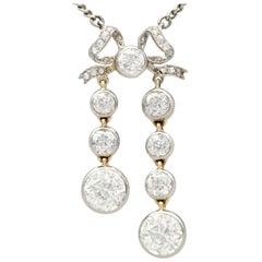 Antique 5.15 Carat Diamond and Yellow Gold Bow Pendant Circa 1920
