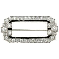Antique 6.29 Carat Diamond and Onyx Platinum Brooch