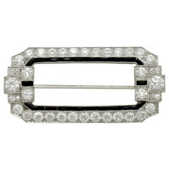 Antique 6.29 Carat Diamond and Onyx Platinum Brooch