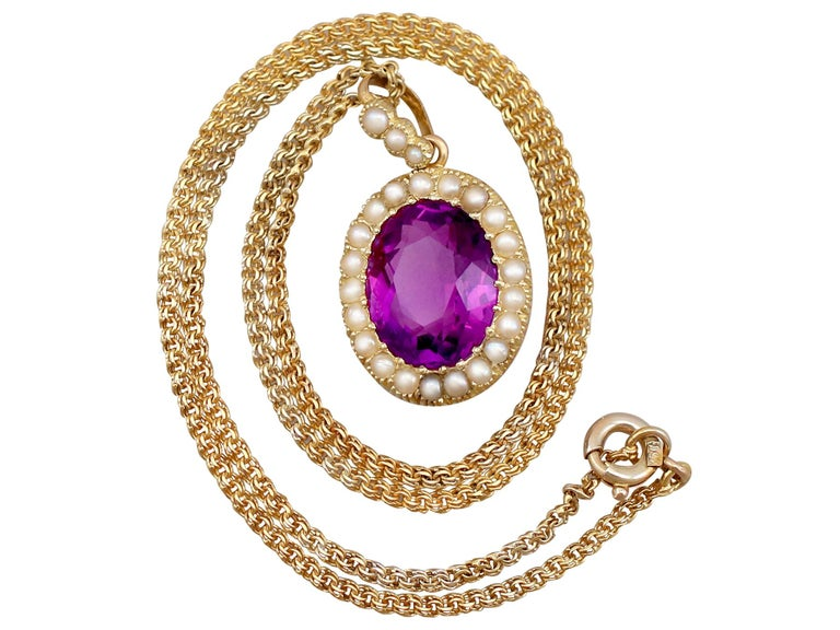 An impressive antique 6.56 carat amethyst and seed pearl, 15k yellow gold pendant with 18k yellow gold chain; part of our antique jewellery collections.  This fine and impressive antique amethyst pendant has been crafted in 15k yellow gold, with an