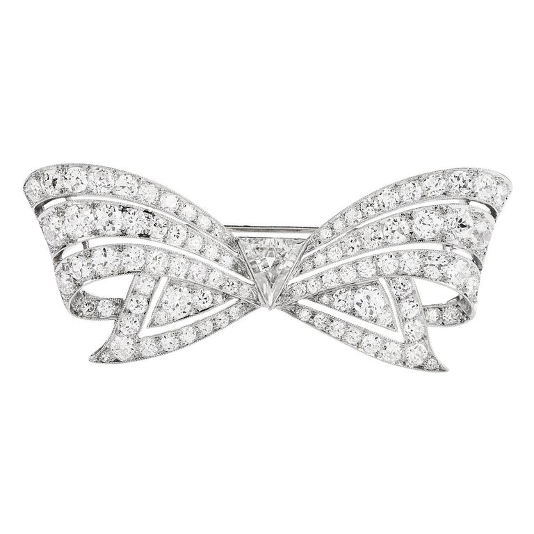 Antique 8.60 Carats Diamond Platinum Cluster Bow Brooch Pin For Sale
