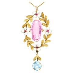 Antique 8.84 Carat Pink Topaz Aquamarine Ruby and Enamel Yellow Gold Pendant