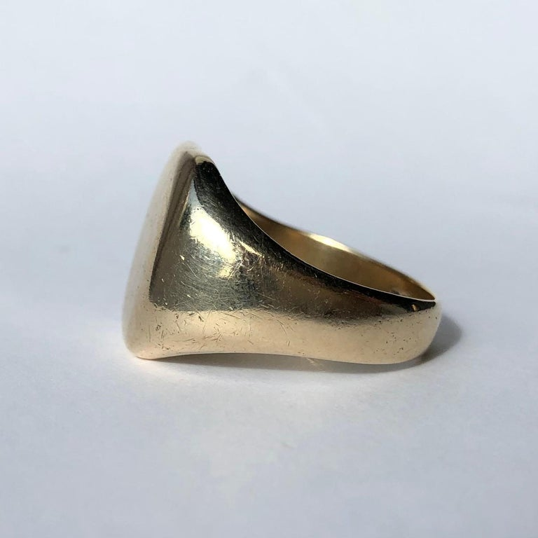 This signet ring has a large face and a really lovely chunky feel to it. The edges of the gold are so smooth and flow nicely. Made in Birmingham, England.   Ring Size: Q 1/2 or 8 1/4 Face Dimensions: 16x14mm  Weight: 10.06g