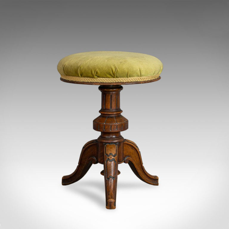 This is an antique adjustable piano stool. An English, Victorian walnut music seat dating to the late 19th century, circa 1870.  Select walnut displays a rich caramel hue with fine grain interest Good consistent colour throughout and a desirable