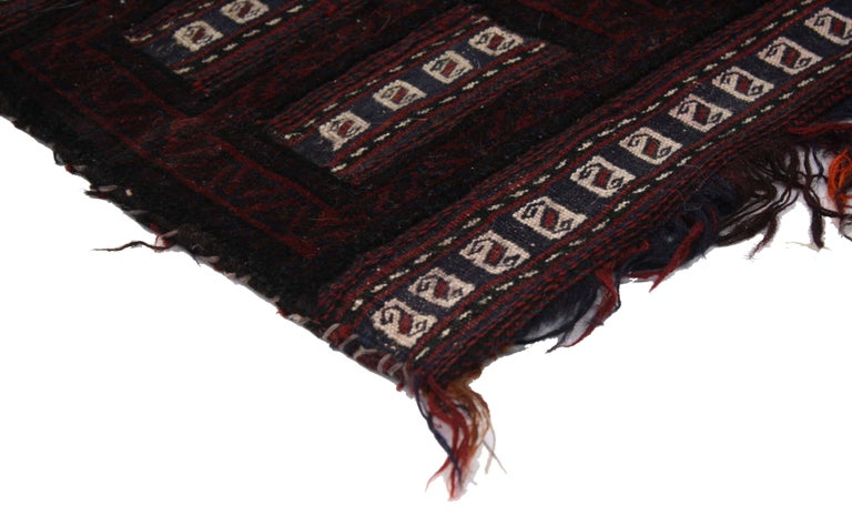 76638, antique Afghan Balouch salt bag, wall hanging, Afghan Tapestry, Tribal textile. This hand knotted wool antique Afghan Balouch salt bag features ancient tribal motifs, S-hooks, and uneven fringe hangs from the bottom. The Afghani Salt Bags
