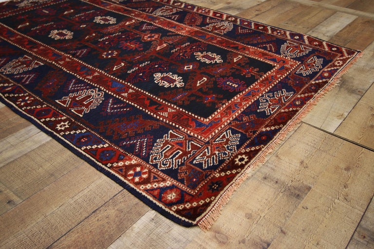74647, antique Afghani tribal rug or kitchen, bath, foyer or entryway. This hand-knotted wool antique Afghani tribal rug features a geometric pattern in a saturated color palette. Immersed in Afghani history and elements of contrast, this antique