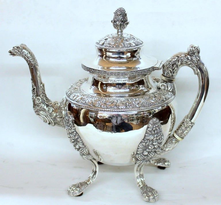 Rare and important antique American very heavyweight coin silver (.900 fine) rococo style four piece tea set including exceptional teapot, two handled covered sugar bowl, cream jug and waste bowl.  Maker: Andrew de Milt, New York  Please note the