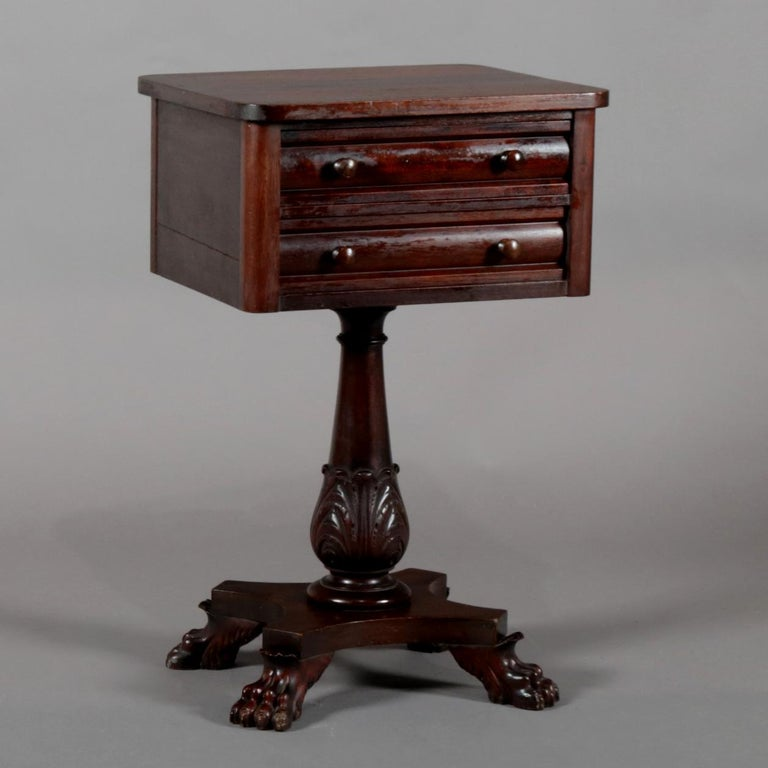An antique American Empire side stand features mahogany construction with case having two convex drawers surmounting turned and acanthus carved column raised on base with carved paw feet, circa 1870  ***DELIVERY NOTICE – Due to COVID-19 we are