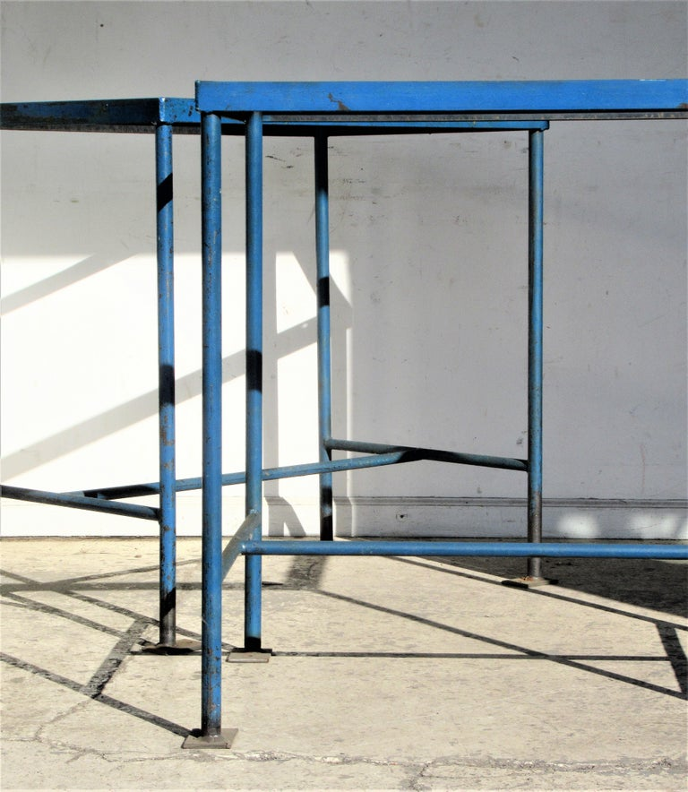 Pair of antique American industrial rectangular iron tables with great architectonic form and the best beautifully aged old original blue enamel painted surface. Direct from a long closed factory in Central New York State, Circa 1930 - 1940.