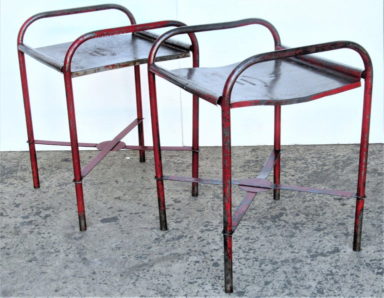 American industrial iron tables / stands in beautifully aged worn original factory red enamel painted surface. The top metal plate is stamped Protectoseal Co. Chicago 1411A, circa 1920-1930. Look at all pictures and read condition report in comment
