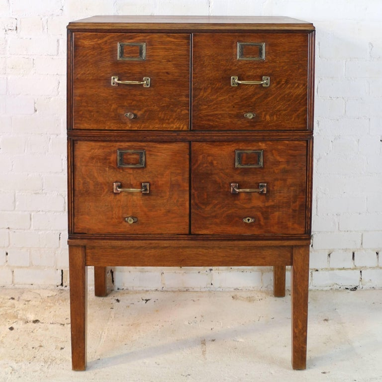 A rare double width antique quarter-sawn oak filing cabinet dating to circa  1910. - Antique American Oak Filing Cabinet, Circa 1910 At 1stdibs
