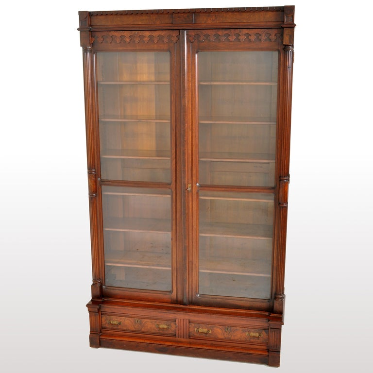 Antique American Renaissance Revival Eastlake Carved Walnut Tall Bookcase, 1875 In Good Condition For Sale In Portland, OR
