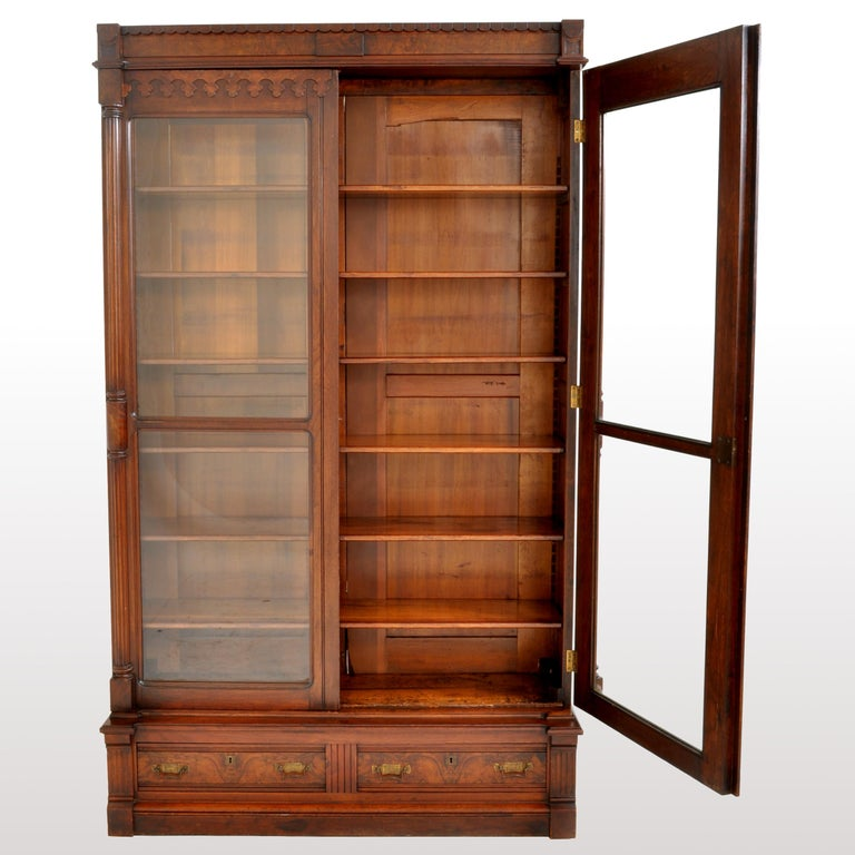 Late 19th Century Antique American Renaissance Revival Eastlake Carved Walnut Tall Bookcase, 1875 For Sale