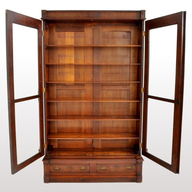 Antique American Renaissance Revival Eastlake Carved Walnut Tall Bookcase, 1875 For Sale 1